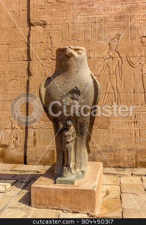 Horus Edfu stock photo, a vertical view of Horus at the entrance of the Temple of Edfu. Nubia, Egypt. by Noelia