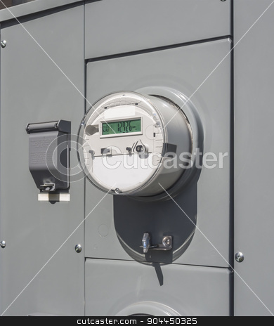 Electricity usage meters  stock photo, electric meter on the side of a small mall by Christian Delbert