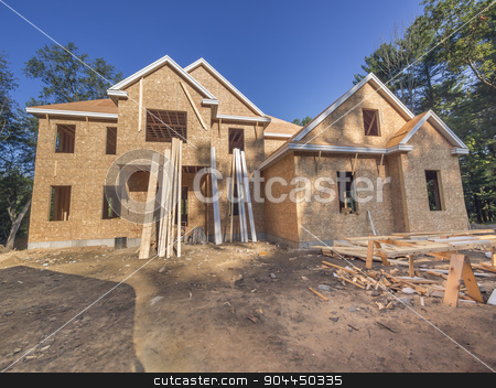 New house construction stock photo, new single family home under construction by Christian Delbert