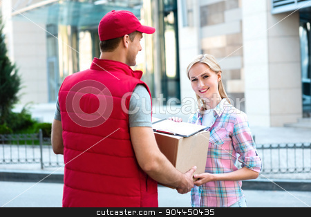 First class delivery service. Courier Delivering Package By Van. stock photo, Colorful picture of courier delivers package for woman. Woman accepts the parcel and smiling.   by Dmytro Sidelnikov