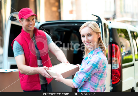 Concept of courier delivers package for woman stock photo, Colorful picture of courier delivers package for woman. Woman is receiving the parcel and smiling.   by Dmytro Sidelnikov