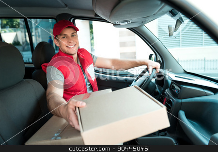 Courier Delivering Package By Van stock photo, Colorful picture of courier delivers package. Man is sitting in the car, looking at camera and smiling. by Dmytro Sidelnikov