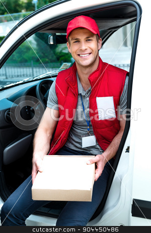 Courier Delivering Package By Van stock photo, Colorful picture of courier delivers package. Man is sitting in the car, holding the box and smiling. by Dmytro Sidelnikov