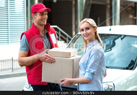 Concept of courier delivers package for woman stock photo, Colorful picture of courier delivers package for woman. Courier is giving the woman a box. Woman accepts the parcel. by Dmytro Sidelnikov