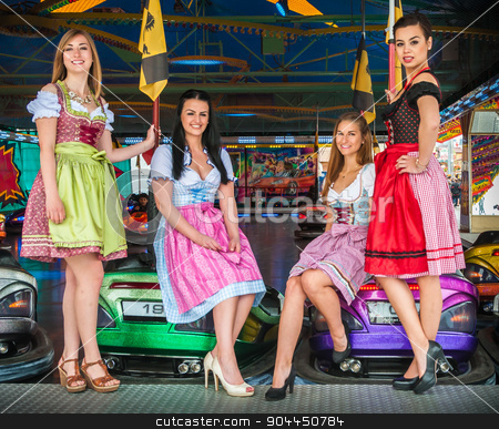 Young and attractive women at Oktoberfest with traditional dirndl dresses, autoscooter in the background stock photo, Joyful and attractive women at Oktoberfest with traditional dirndl dresses, autoscooter in the background. Mixed nationalities, German, Asian, Slavic by uleiber