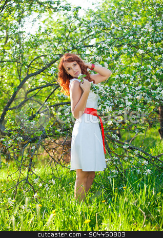 Free Happy Woman with Gorgeous Red Hair Enjoying Nature. Beauty Young Girl Outdoor in Spring Garden. Freedom concept. Healthy Smiling Girl over Green Flowers Nature Background. Apple-trees in Blossom stock photo, Free Happy Woman with Gorgeous Red Hair Enjoying Nature. Beauty Young Girl Outdoor in Spring Garden. Freedom concept. Healthy Smiling Girl over Green Flowers Nature Background. Apple-trees in Blossom. by traza