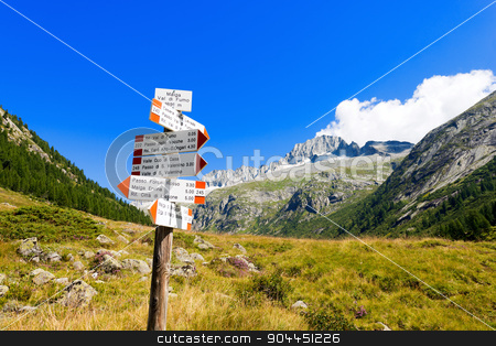 Directional Trail Signs in Mountain - Italian Alps stock photo, Typical directional trail signs in mountain in the National Park of Adamello Brenta. Trentino Alto Adige, Italy by catalby