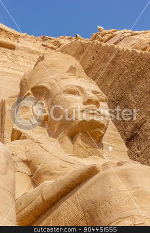 detail colossus Abu Simbel stock photo, a vertical view of a detail of the colossus of Abu Simbel, Nubia, Egypt by Noelia