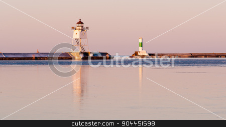 Morning Light Harbor Breakwater Lighthouse Lake Superior Minnesota stock photo, The water is still frozen here in April on Lake Superior by Christopher Boswell
