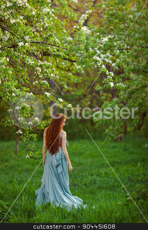 Young beautiful woman in  blooming garden stock photo, beautiful young brunette woman standing near the apple tree by Dmytro Buianskyi