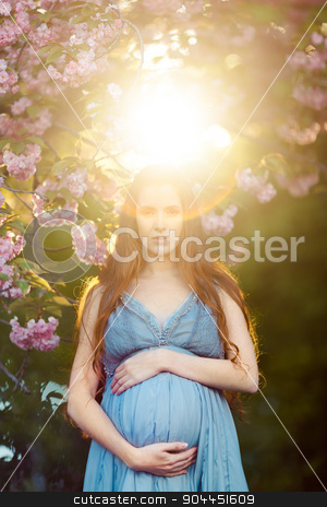 Young  pregnant woman relaxing and enjoying life in nature stock photo, Young beautiful pregnant girl. Beams of the sunset by Dmytro Buianskyi