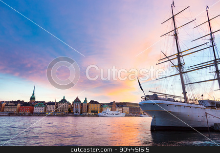 Traditional seilboat in Gamla stan, Stockholm, Sweden, Europe. stock photo, Panoramic view of swedish capital Stockholm in sunset. Large traditional wooden sailboat and old medieval downtown of Gamla stan in the background. Copy space. Horisontal composition. by kasto