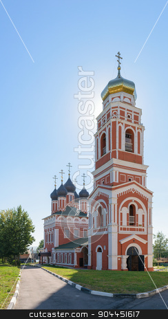 Trinity Church of brick against the blue cloudless sky on day stock photo, BOLHOV OF OREL REGION, RUSSIA - AUGUST 15, 2015: Trinity Church of brick against the blue cloudless sky on a sunny summer day by IgorTravkin
