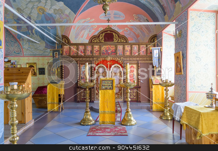 Any lectern and candlesticks in hall of worship in church stock photo, BOLHOV OF OREL REGION, RUSSIA - AUGUST 15, 2015: Several lectern and candlesticks in hall of worship in Holy Trinity Church. Iconostasis in background by IgorTravkin