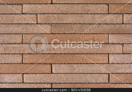 Brown Brick Interior Wall stock photo, An interior wall of a house covered with long and thin brown bricks. by Scott Dumas