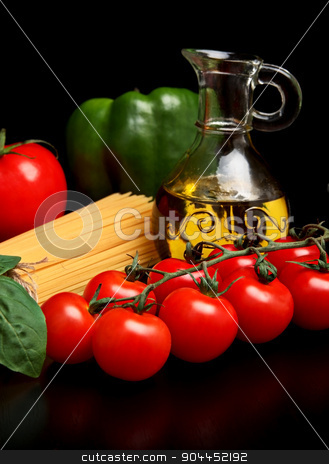 Long pasta raw isolated on black with tomatoes and olive oil stock photo, Long group of raw pasta tied with string isolated on black board with tomatoes and green pepper and carafe full of olive oil by Tadeusz Wejkszo