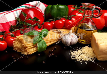 Pasta raw isolated on black with tomatoes,olive oil,garlic verti stock photo, Long group of raw pasta tied with string isolated on black board with basil,tomatoes and carafe full of olive oil upright by Tadeusz Wejkszo
