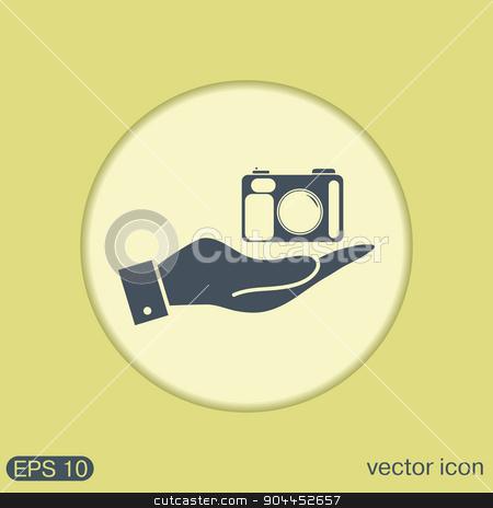 hand holding a photo camera stock vector clipart, hand holding a photo camera by LittleCuckoo