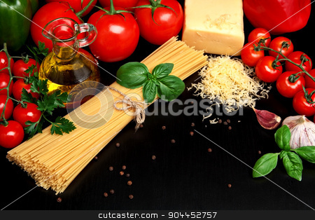 Pasta raw isolated on black with tomatoes,olive oil,garlic stock photo, Long group of raw pasta tied with string isolated on black board with basil,tomatoes and carafe full of olive oil upright from above view by Tadeusz Wejkszo