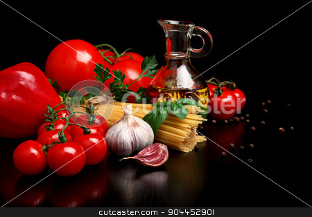 Kit for the preparation of spaghetti on black stock photo, Kit for the preparation of spaghetti on black background with pasta,tomatoes,olive oil,basil leaves, pepper and garlic by Tadeusz Wejkszo