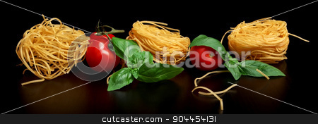 Group of three round balls of raw pasta on black stock photo, Round balls of raw pasta on black background by Tadeusz Wejkszo