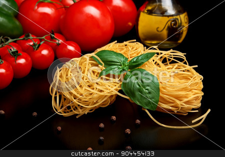 Round balls of pasta with tomatoes,basil,olive oil on black stock photo, Round balls of pasta with tomatoes,basil,olive oil on black background by Tadeusz Wejkszo