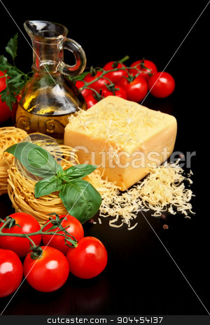 Round balls of pasta with cheese, tomatoes,basil,olive oil on black stock photo, Round balls of pasta with tomatoes,basil,olive oil on black background by Tadeusz Wejkszo