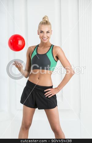 Studio portrait of a pretty rhythmic gymnastics. stock photo, Studio portrait of a pretty rhythmic gymnastics with red ball. by bezikus