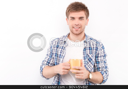 Handsome man isolated on white stock photo, Portrait of a handsome young man standing looking at the camera smiling and holding a yellow cup of coffee in his hands, wearing white t-short and blue checkered shirt, isolated in white background by Zinkevych