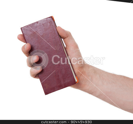 Old diaries in a hand stock photo, Old diarie in the hand of an adult man by michaklootwijk