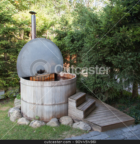 Wooden hot tub in the alps stock photo, Wooden hot tub in the alps, Switzerland by michaklootwijk