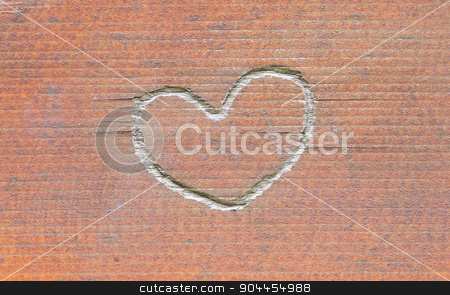 Heart carved in wood stock photo, Heart carved in wood, old and worn by michaklootwijk