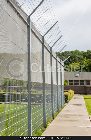 Fence around restricted area stock photo, Fence around restricted area, old jail in the Netherlands by michaklootwijk