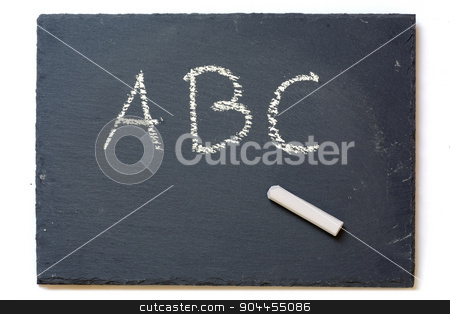 chalkboard with chalk and the letters A, B, C, isolated on white stock photo, small slate chalkboard with chalk and the letters A, B, C, isolated on a white background, copy space by Maren Winter