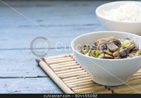 mushroom vegetable dish and cooked rice in white bowls on a bamb stock photo, mushroom vegetable dish and cooked rice in porcelain bowls on a bamboo mat and rustic blue wood, closeup with selected focus and narrow depth of field, copy space by Maren Winter