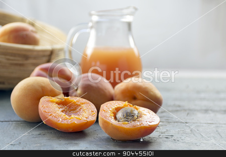 Fresh apricots and juice on light gray wood, copy space in the b stock photo, Fresh apricots and juice on light gray wood, copy space in the blurry background, selected focus, narrow depth of field by Maren Winter