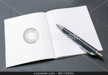 ballpoint pens and a blank notebook with graph paper stock photo, ballpoint pens and a blank notebook with graph paper on a gray blotting pad, copy space by Maren Winter