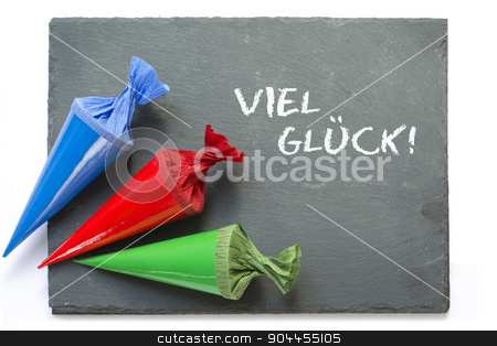 school cones on a  blackboard with message good luck stock photo, three colurful school cones on a blank blackboard, german words viel glueck, that means good luck, isolated on a white background  by Maren Winter