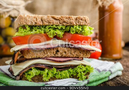 Smoked meat sandwich stock photo, Sandwich with fresh smoked meat, cheese, lettuce and tomato with homemade ketchup by Peteer