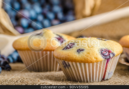 Blueberry muffins stock photo, Blueberry muffins milk and jam in background and basket full of blueberries by Peteer