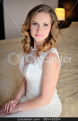 Portrait of a bride in a hotel room stock photo, Portrait of a bride in a hotel room. by timonko