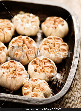 rustic roasted garlic stock photo, close up of rustic roasted garlic by zkruger