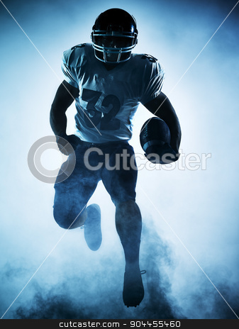 american football player silhouette stock photo, one american football player portrait in silhouette shadow on white background by Ishadow
