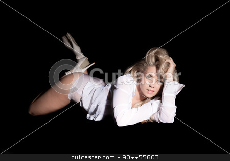 sexy woman laying on stomach stock photo, sexy woman laying on stomach with a black background by sijohnsen