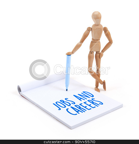 Wooden mannequin writing - Jobs and careers stock photo, Wooden mannequin writing in a scrapbook - Jobs and careers by michaklootwijk