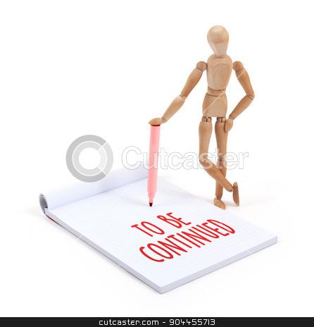 Wooden mannequin writing - To be continued stock photo, Wooden mannequin writing in a scrapbook - To be continued by michaklootwijk