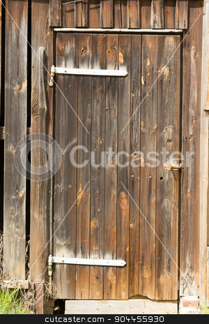 brown wooden door stock photo, Ramshackle wooden door to a shed by Bernd Kröger