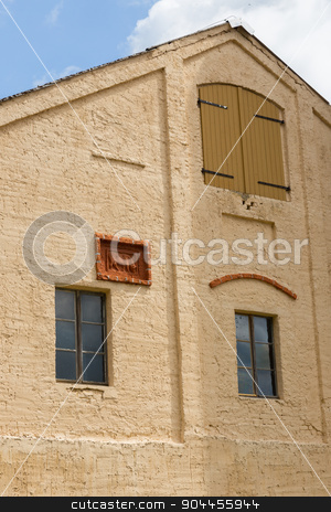 barn facade stock photo, Yellow painted facade of a barn with relief by Bernd Kröger