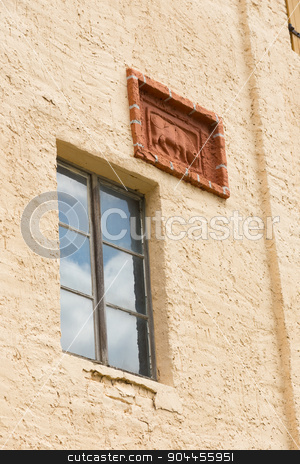 window and relief stock photo, Window and cattle relief on a barn facade by Bernd Kröger