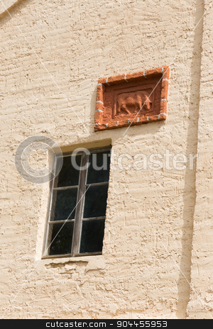 Relief and window stock photo, Window and cattle relief on a barn facade by Bernd Kröger